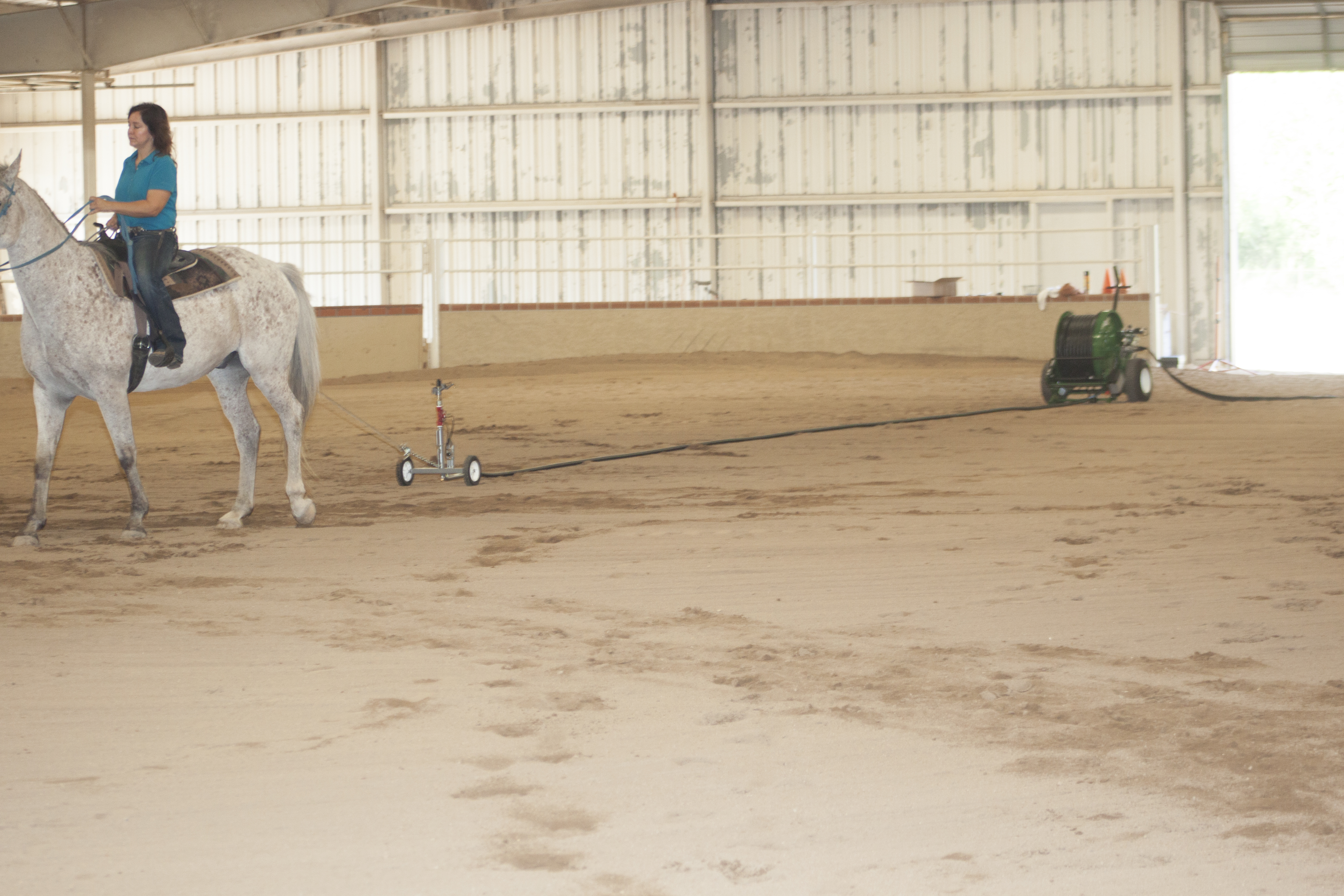 image of Kifco water-reel watering arenas, specifically horse arenas